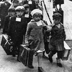 Finnish children with suitcases being evacuated from the country during World War II