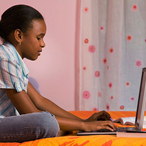 Young girl on laptop computer.