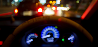 Stock image of an out-of-focus car dashboard at night