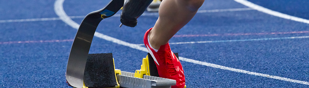 A runner with a prosthetic leg on a track.