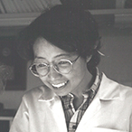 Black and white, undated photograph of a young Dr. Ozato and a colleague, both wearing lab coats.