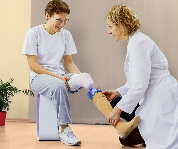Stock image of a patient receiving a prosthetic device.
