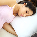 Pregnant woman sleeping on her left side.