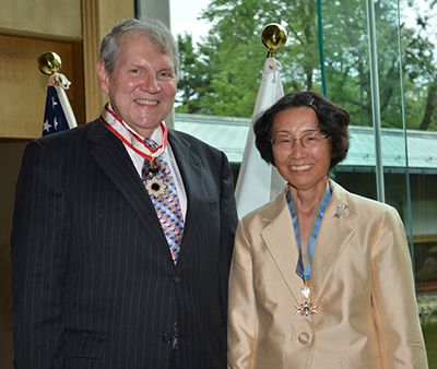 Photograph of the researchers smiling and wearing their honorary ribbons in 2012.