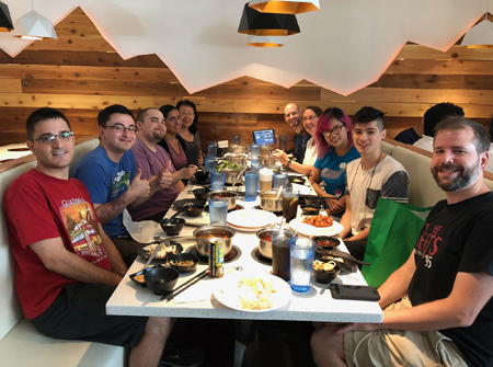 Lab members eating out at a Korean hot pot restaurant.