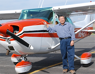 Dr. Gary Shen standing next to plane.