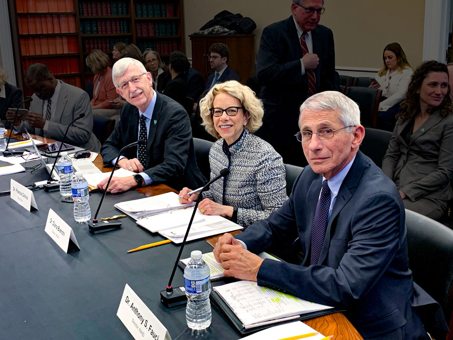 Francis Collins, Diana Bianchi and Anthony Fauci seated at a table.