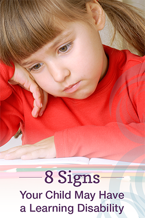 child reading book; text at bottom: 8 signs your child may have a learning disability