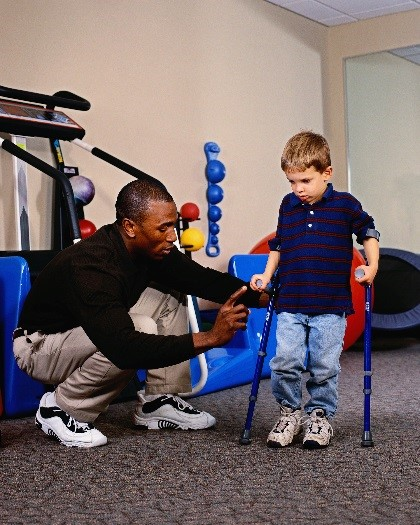 young child in physical therapy session