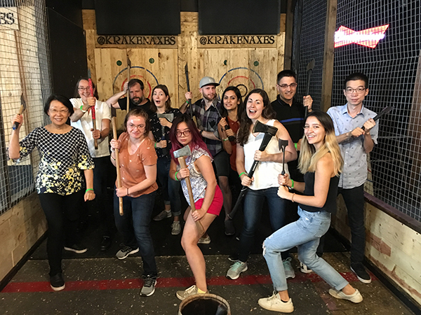 Group photo of lab at an axe-throwing outing.