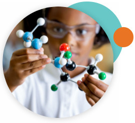 A young girl wearing lab goggles and holding a molecular model.