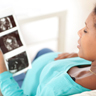 pregnant woman reviewing ultrasound scans