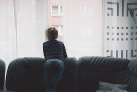 boy looking out window, stock photo