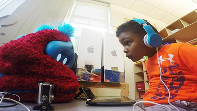 Preschooler interacts with a social robot companion.