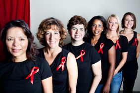 Women wearing AIDS ribbon
