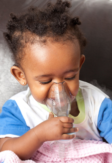 small child with inhalation mask