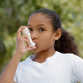 Young girl with inhaler