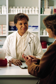 Pharmacist assisting a client