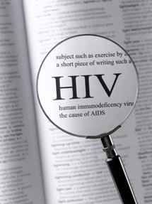 Magnifying glass and dictionary, with HIV enlarged