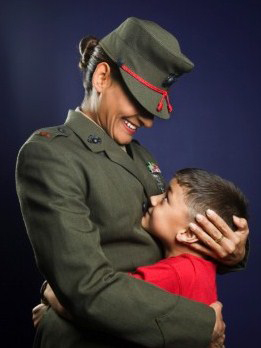 Military mother holding son