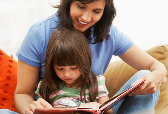 Stock image of parent and child  reading.