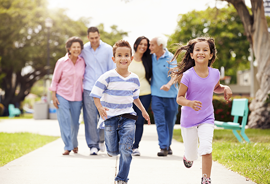 Stock image of family and running  children.