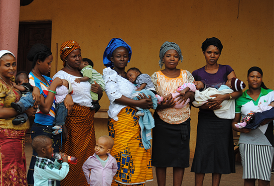 Pregnant women and their children  outside their church in Nigeria. Credit: Dina Patel, Healthy Sunrise  Foundation