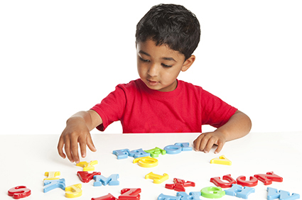 Boy playing with alphabet