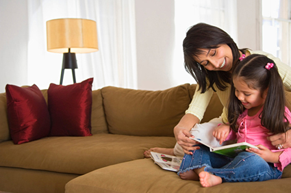 Mother and young daughter reading