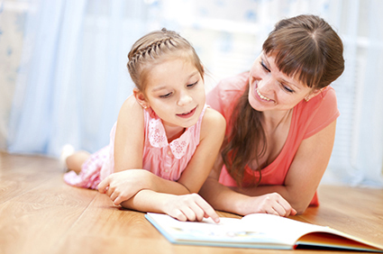 Daughter reading with mother