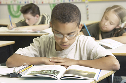 Boy in school reading